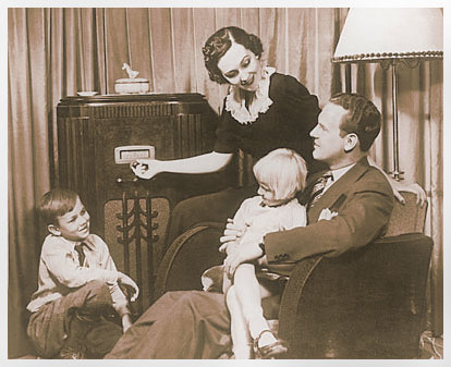 A family sits around the radio