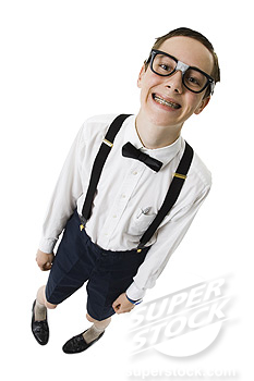 Male nerd with suspenders and tape on eyeglasses smiling with braces