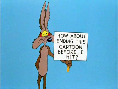 Wile E. Coyote holdign sign