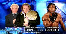 Induction: Booker T vs. Triple H – HHH goes KKK