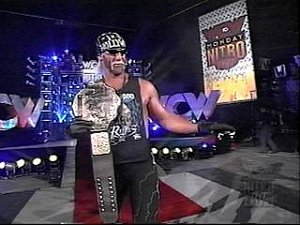 Hulk Hogan holding WCW NWO spray paint belt