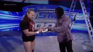 …and hand it over again, this time to Daniel Bryan…