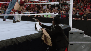 …who lost track of the belt during a brawl, allowing R-Truth to sneak away with it again in a burlap bag.